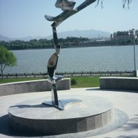 'Greeting the Sun' stainless steel 300cm high 2001. Collection: Yanqing Government: Public Park, Yanqing, China