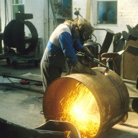 Derek Howarth cutting steel for 'Cavalcade' 1990
